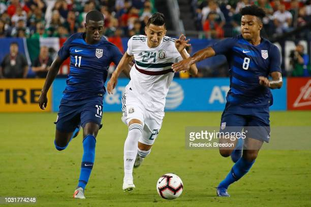 Tim Weah and Weston McKennie of the USA and Roberto Alvarado of Mexico chase a ball during the first half of a friendly match at Nissan Stadium on...