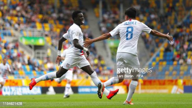 Tim Weah of the United States celebrates with team mate Alex Mendez after scoring his team's first goal during the 2019 FIFA U20 World Cup Quarter...