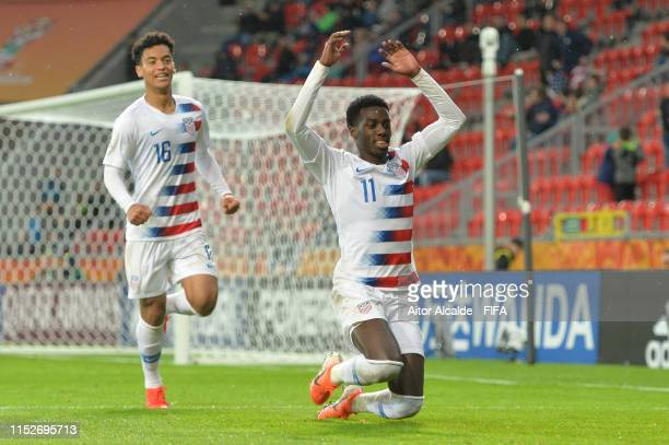 Tim Weah of the United States celebrates with team mate Brandon Servania after scoring their team's first goal during the 2019 FIFA U20 World Cup...