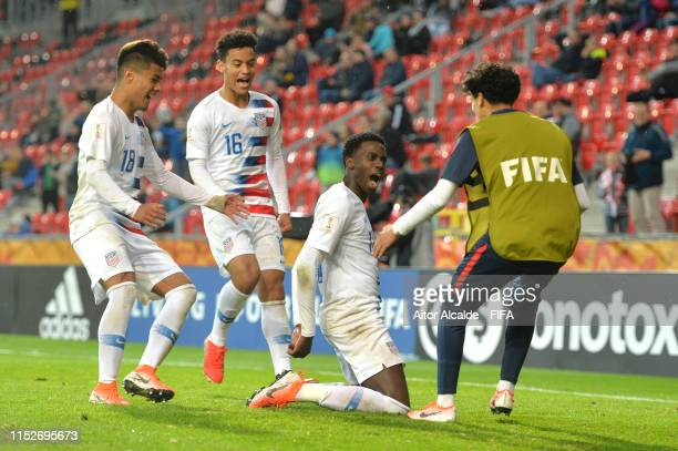 Tim Weah of the United States celebrates with team mates after scoring their team's first goal during the 2019 FIFA U20 World Cup group D match...