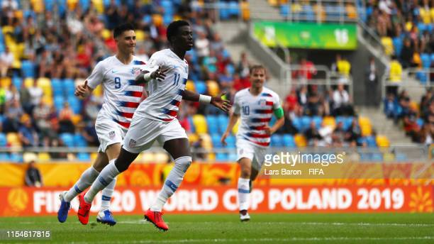 Tim Weah of the United States celebrates with team mates Sebastian Soto and Paxton Pomykal of the United States after scoring his team's first goal...