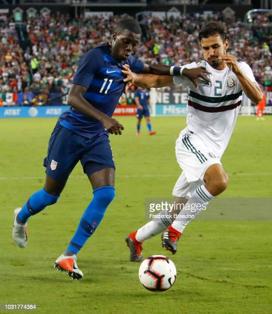 Tim Weah of the USA and Oswaldo Alanis of Mexico go for the ball during the second half of a friendly match at Nissan Stadium on September 11 2018 in...