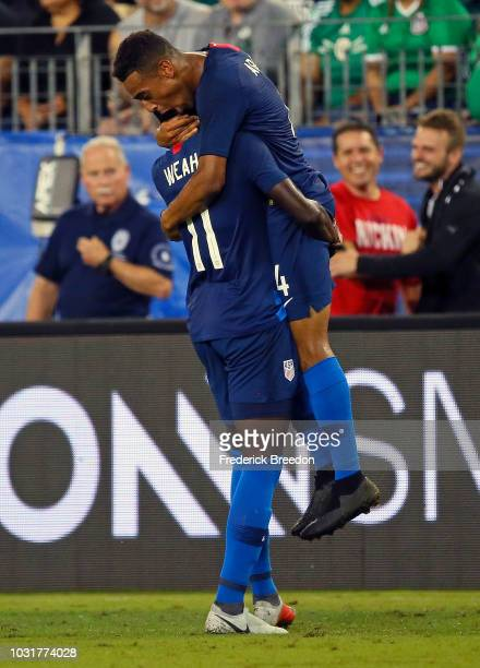 Tim Weah of the USA congratulates teammate Tyler Adams on scoring a goal against Mexico during the second half of a friendly match at Nissan Stadium...
