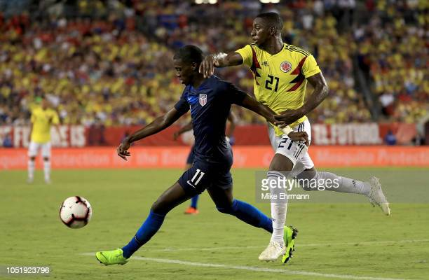 Tim Weah of Unites States and JosŽ Izquierdo of Colombia fight for the ball during an International Friendly at Raymond James Stadium on October 11...