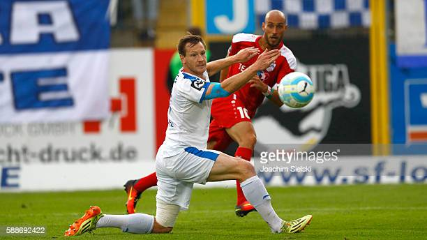 Tim Wendel of Lotte challenges Daniel Brueckner of Erfurt during the third league match between SF Lotte and RotWeiss Erfurt at Frimo Stadion on...