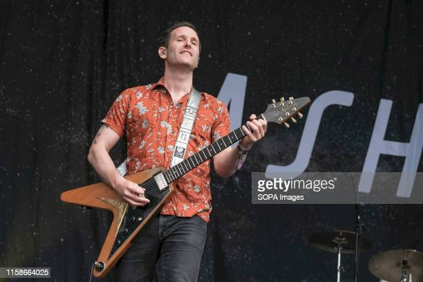 Tim Wheeler lead singer and guitarist with Northern Irish indie rock band Ash performing live on stage at Camp Bestival family festival in Lulworth...