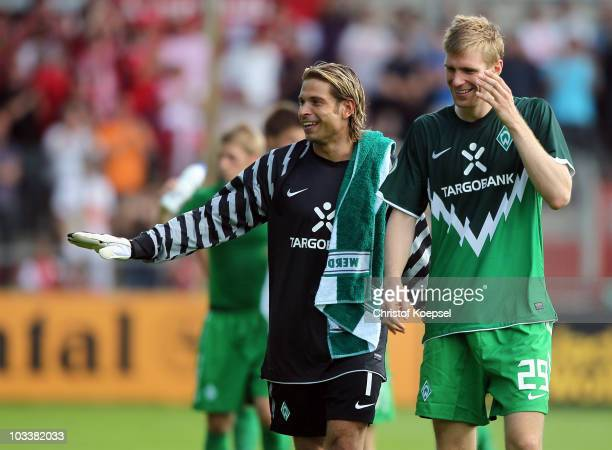 Tim Wiese and Per Mertesacker of Bremen celebrate the 4-0 victory after the DFB Cup first round match between Rot Weiss Ahlen and SV Werder Bremen at...
