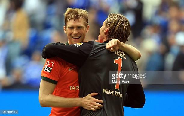 Tim Wiese goalkeeper of Bremen celebrates with team mate Per Mertesacker after the Bundesliga match between FC Schalke 04 and Werder Bremen at...