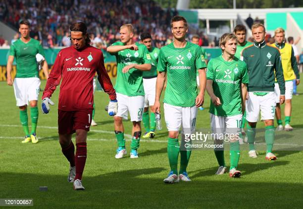Tim Wiese Markus Rosenberg and Marko Marin of Bremen look dejected after losing 12 the first round DFB Cup match between 1 FC Heidenheim and Werder...