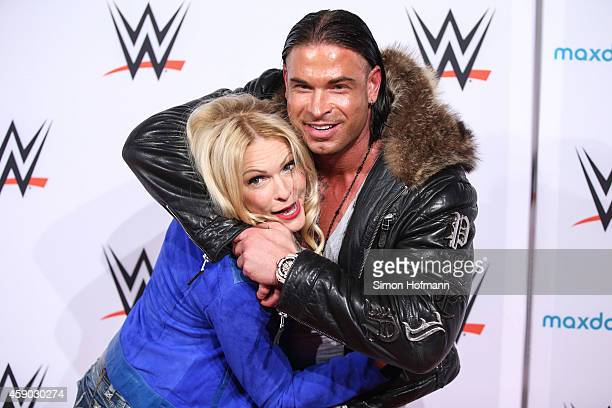 Tim Wiese poses with Sonya Kraus prior to WWE Live 2014 at Festhalle on November 15, 2014 in Frankfurt am Main, Germany.