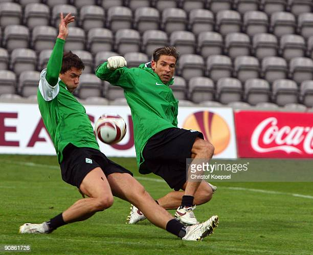 Tim Wiese tackles Sebastian Boenisch during the training session at the stadium of Madeira on September 16 2009 in Funchal Madeira Portugal The...