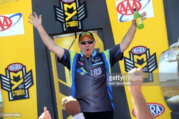 Tim Wilkerson Ford Shelby Mustang NHRA Funny Car is introduced to the crowd during prerace festivities before the start of the NHRA AAA Midwest...