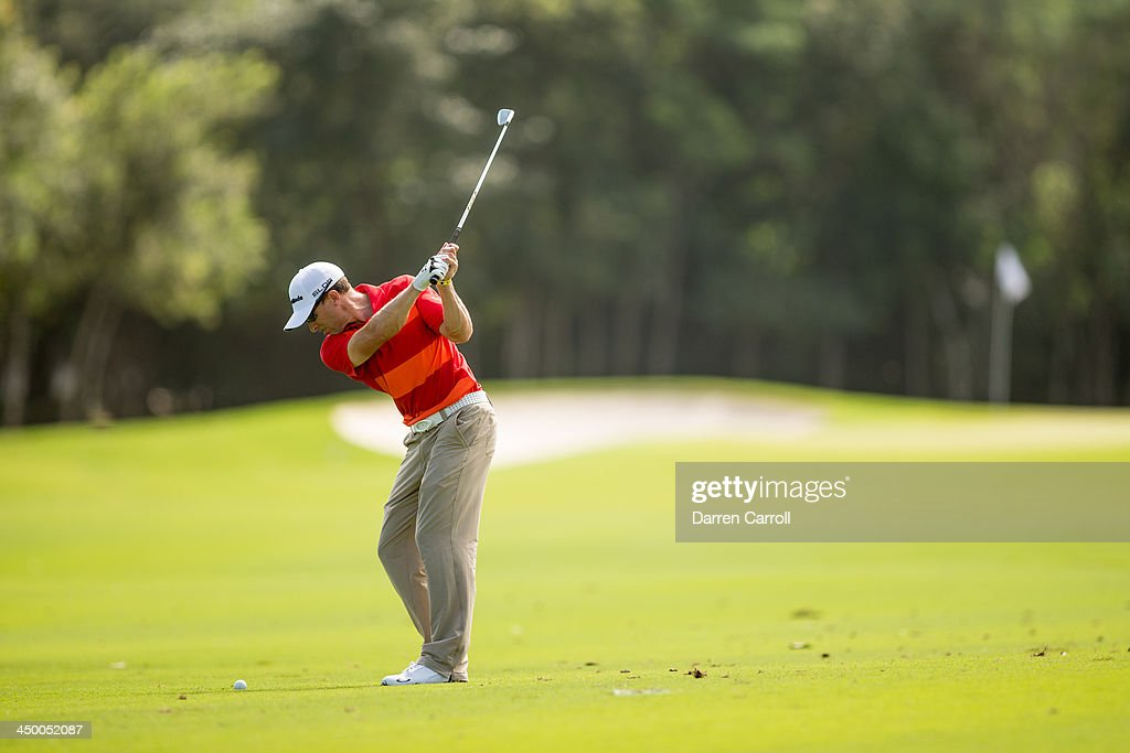 Tim Wilkinson of the New Zealand plays an approach shot at the 9th hole during continuation the second round of the 2013 OHL Classic at Mayakoba, played at El Camaleon Golf Club on November 16, 2013 in Playa Del Carmen, Mexico.