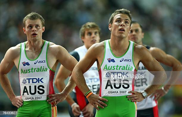 Tim Williams and Aaron RougeSerret of Australia check their times as the German team look on following the Men's 4 x 100m Relay First Round on day...