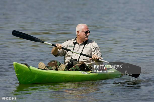 Tim Williams Dean of Gator Wrestling and Director of Media Production at Gatorland in Orlando Florida uses a kayak as he searches for the alligator...