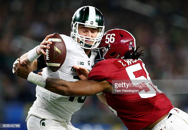 Tim Williams of the Alabama Crimson Tide sacks Connor Cook of the Michigan State Spartans in the third quarter during the Goodyear Cotton Bowl at ATT...