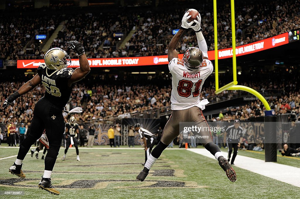Tim Wright #81 of the Tampa Bay Buccaneers catches a touchdown pass in front of Curtis Lofton #50 of the New Orleans Saints during a game at the Mercedes-Benz Superdome on December 29, 2013 in New Orleans, Louisiana.