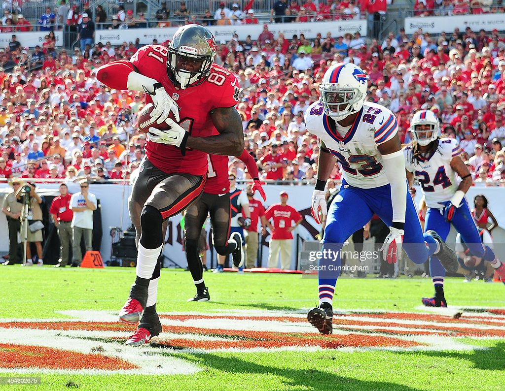Tim Wright #81 of the Tampa Bay Buccaneers makes a catch for a touchdown against Aaron Williams #23 of the Buffalo Bills at Raymond James Stadium on December 8 2013 in Tampa, Florida.