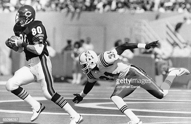 Tim Wrightman of the Chicago Bears heads upfield against Fred Marion of the New England Patriots during the game at Soldier Field on September 15...