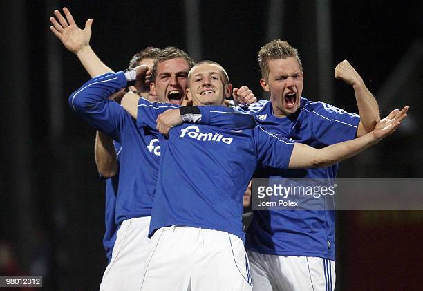 Tim Wulff of Kiel celebrates with his team mates after scoring his team's second goal during the 3 Liga match between Holstein Kiel v SpVgg...
