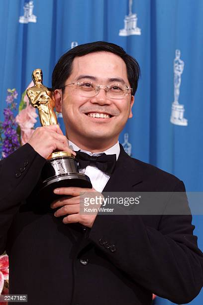 Tim Yip Academy Award winner for Achievement In Art Direction for his work on Crouching Tiger Hidden Dragon poses with his Oscar backstage at the...