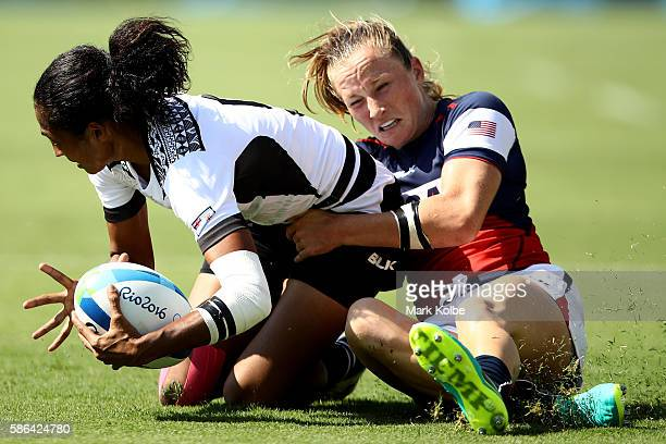 Tima Tamoi of Fiji is tackled by Kathryn Johnson of the United States during the Women's Pool A rugby match between the United States and Fiji on Day...