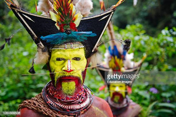 Timan Thumbu Huli Wigman from Tari Southern Highlands, Papua New Guinea Feathers and plumes in head dress include breast shield of Superb Bird of...