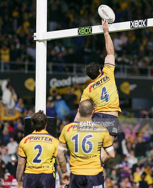Timana Tahu of the Eels enjoys his post try celebration with a slam dunk during the round 23 NRL match between the Parramatta Eels and the Bulldogs...