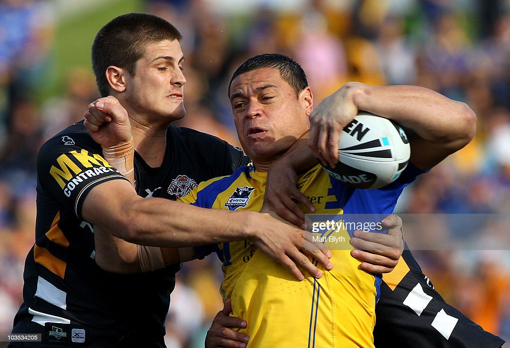 Timana Tahu of the Eels is tackled during the round 24 NRL match between the Parramatta Eels and the Wests Tigers at Parramatta Stadium on August 22, 2010 in Sydney, Australia.