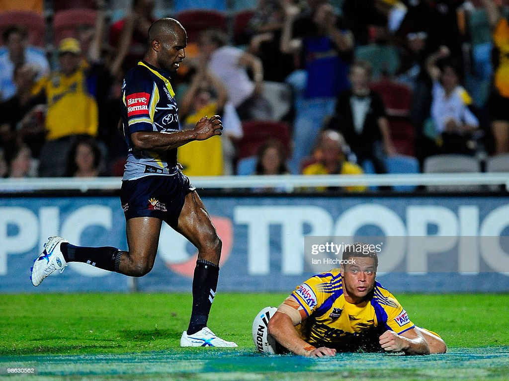 Timana Tahu (r) of the Eels scores a try during the round seven NRL match between the North Queensland Cowboys and the Parramatta Eels at Dairy Farmers Stadium on April 23, 2010 in Townsville, Australia.
