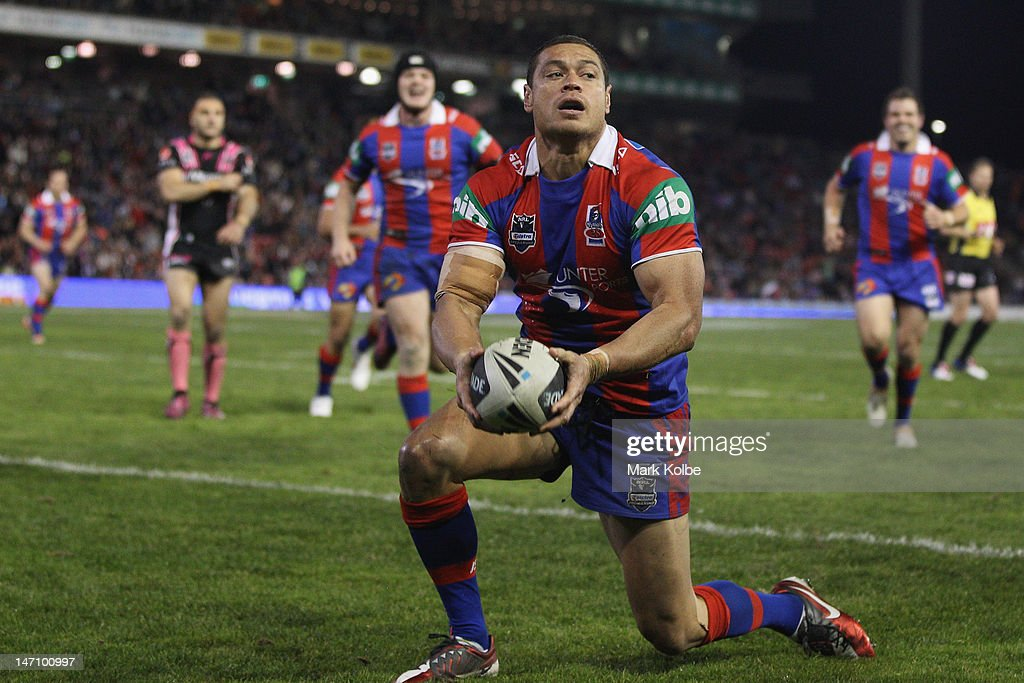 Timana Tahu of the Knights celebrates scoring a try during the round 16 NRL match between the Newcastle Knights and the Wests Tigers at Hunter Stadium on June 25, 2012 in Newcastle, Australia.