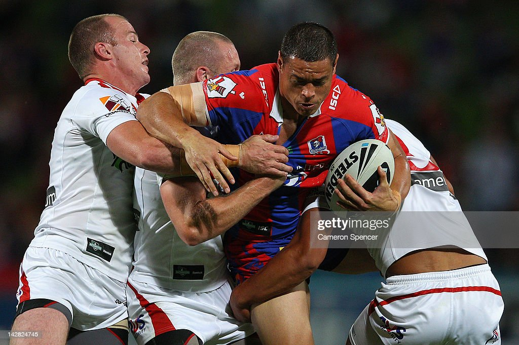 Timana Tahu of the Knights is tackled during the round seven NRL match between the St George Illawarra Dragons and the Newcastle Knights at WIN Jubilee Stadium on April 13, 2012 in Sydney, Australia.