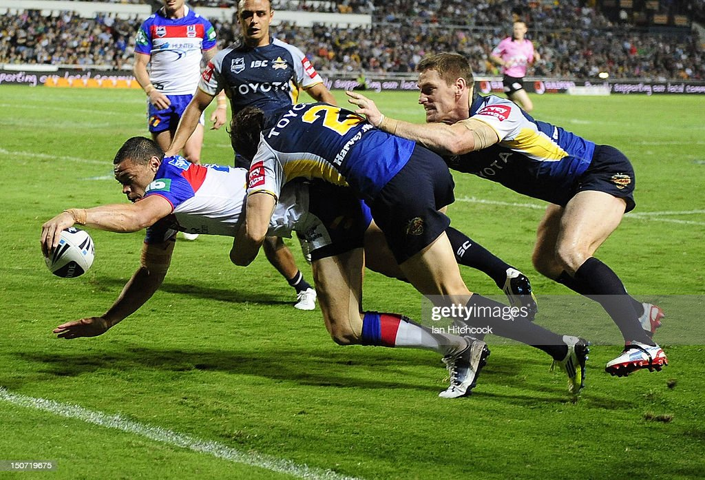 Timana Tahu of the Knights scores a try during the round 25 NRL match between the North Queensland Cowboys and the Newcastle Knights at Dairy Farmers Stadium on August 25, 2012 in Townsville, Australia.