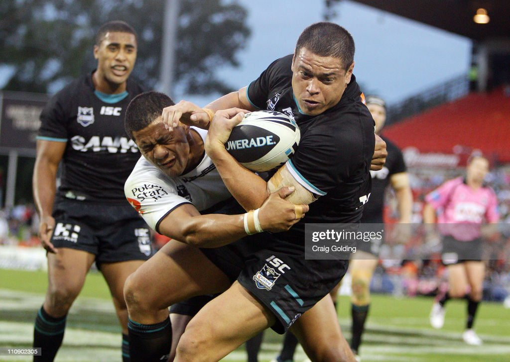 Timana Tahu of the Panthers is tackled during the round three NRL match between the Penrith Panthers and the Cronulla Sharks at Centrebet Stadium on March 26, 2011 in Penrith, Australia.