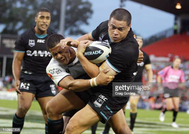 Timana Tahu of the Panthers is tackled during the round three NRL match between the Penrith Panthers and the Cronulla Sharks at Centrebet Stadium on...