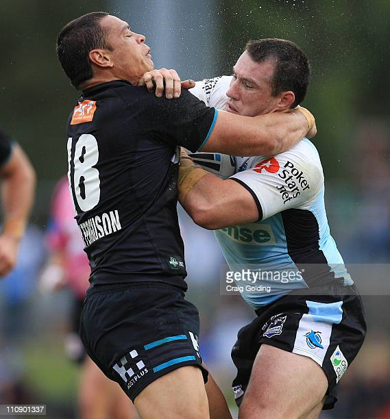 Timana Tahu of the Panthers tackles Paul Gallen of the Sharks during the round three NRL match between the Penrith Panthers and the Cronulla Sharks...