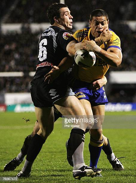Timana Tahu of the Parramatta Eels is tackled by Michael Witt of the Warriors during the NRL qualifying final match between the Warriors and the...