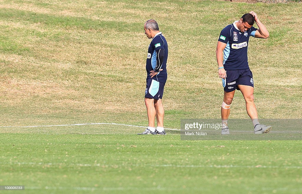 Timana Tahu (R) warms up before a New South Wales Origin training session at WIN Stadium on May 20, 2010 in Wollongong, Australia.