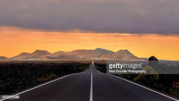 timanfaya national park, lanzarote, spain. - thoroughfare stock photos and pictures