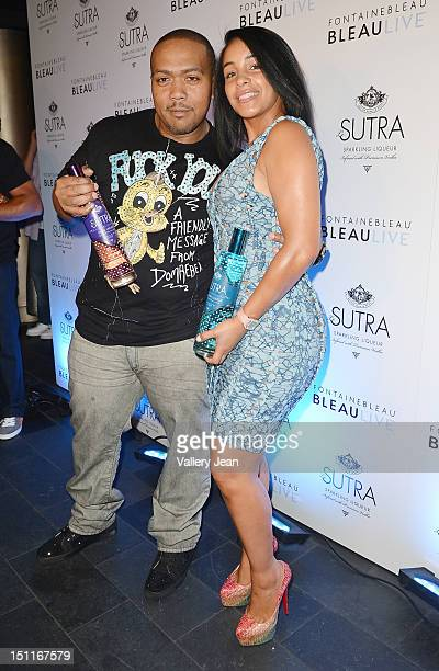 Timbaland and wife Monique Mosley arrive at LeSUTRA Sparkling Liqueur launch at Fontainebleau Miami Beach on September 1 2012 in Miami Beach Florida