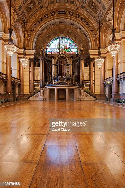 timber floor and pipe organ under decorative arch and stained glass window in the great hall at st georges halll, merseyside, uk - vaudeville stock pictures, royalty-free photos & images