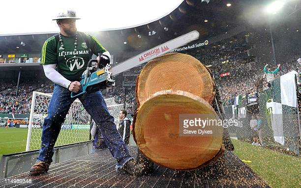 'Timber Joey' mascot of the Portland Timbers cuts off a logs slab after theTimbers scored during the second half of the game against DC United at PGE...