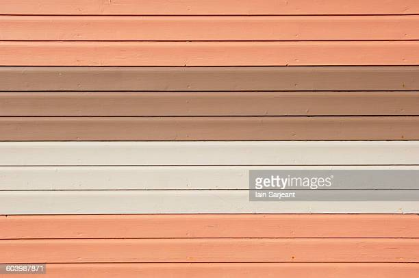 Timber painted pink, brown and white