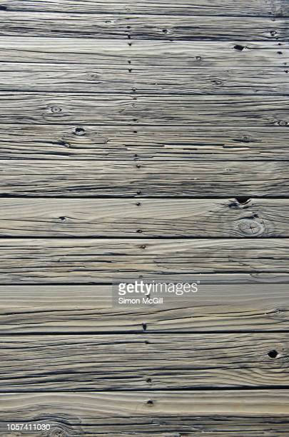 timber planks on a pier - jetty stock pictures, royalty-free photos & images