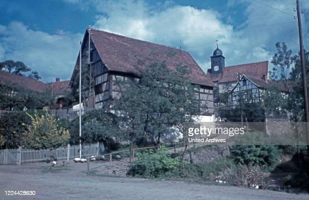 Timbered house and church of the village Weltwitz in Thuringia, Germany 1930s.