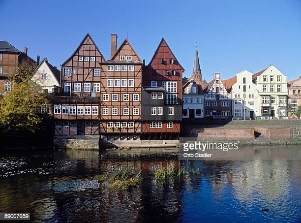 timbered houses by river, lueneburg, germany - lüneburg stock photos and pictures