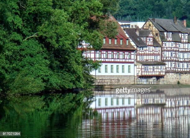 Timberframe houses reflected in the river Fulda, Rotenburg an der Fulda, Hesse, Germany