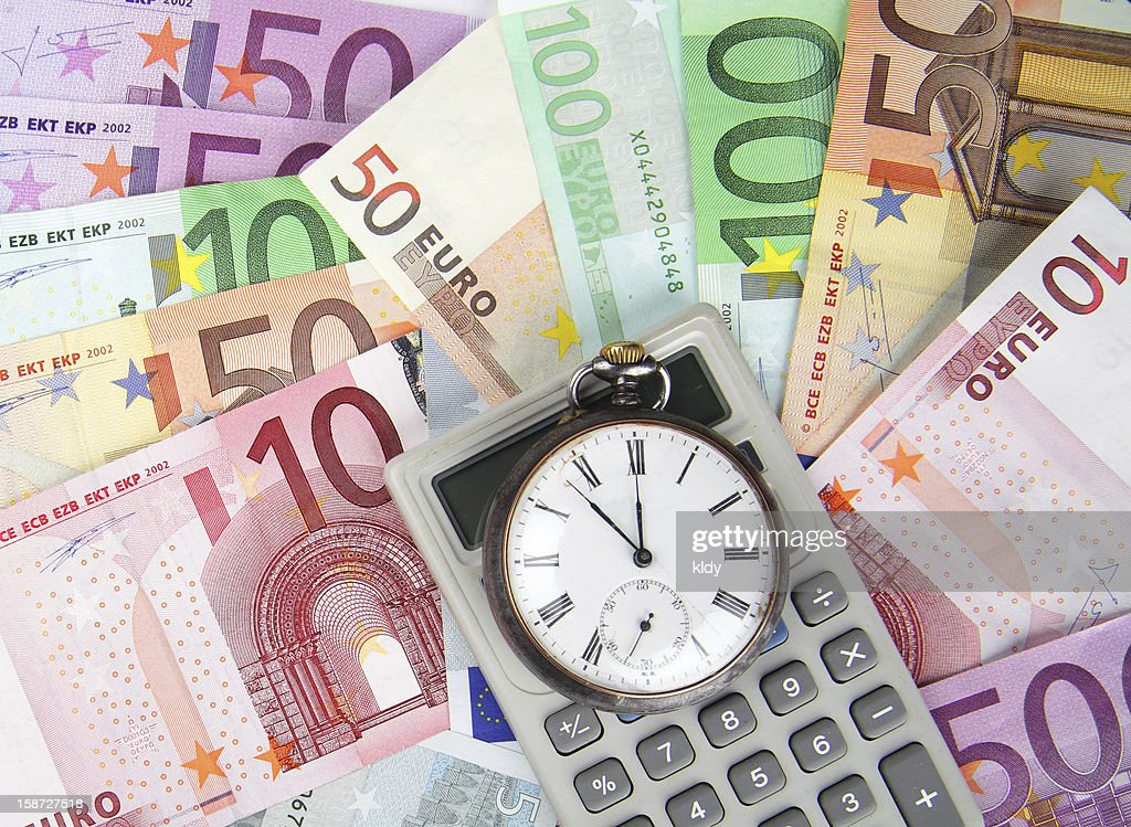 Time And Money Concept Euros Vintage Watch With Calculator Stock Photo