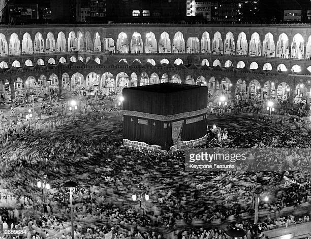 A time exposure photograph showing the whirlpool of movement created by devout Muslims performing the Tawaf the circumambulation of the Ka'bah or...