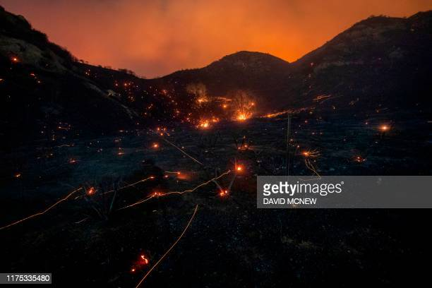 TOPSHOT A time exposure shows embers from Saddleridge Fire blown by the wind in the Porter Ranch section of Los Angeles California on October 11 2019...